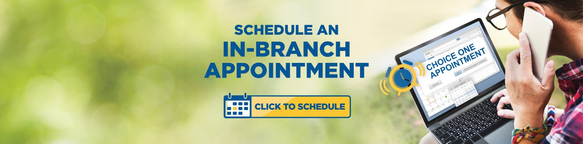 Schedule an in-branch appointment home page banner featuring a man on his laptop speaking into a cell phone.